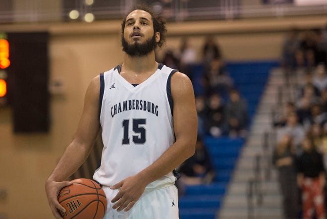 Chambersburg's Tyler Collier sunk two free throws to give Chambersburg a 48-46 win over Harrisburg Friday night.