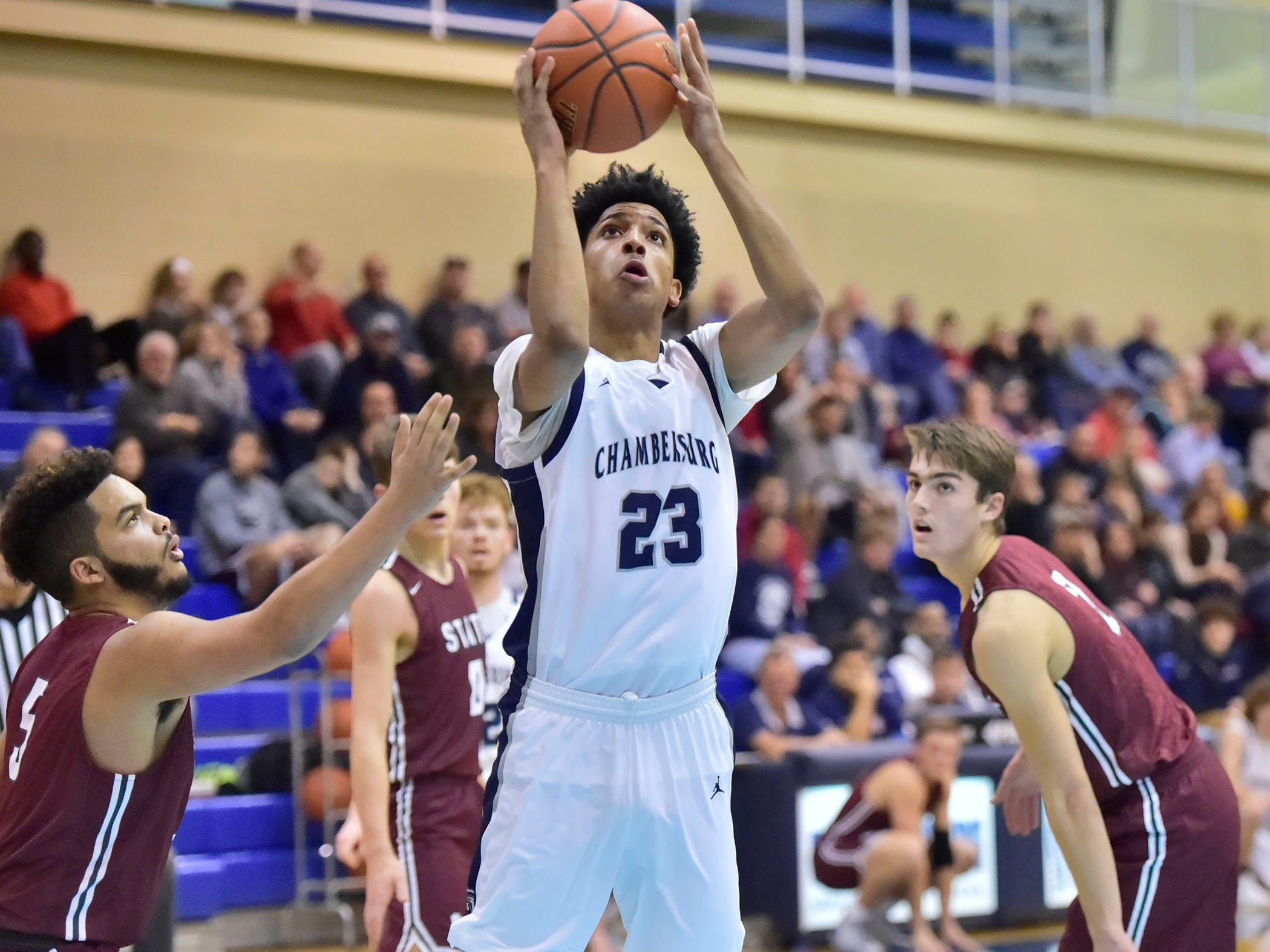 Max Doctor of Chambersburg shoots for the Trojans. Chambersburg dropped a buzzer-beater 42-40 to State College during  D3 basketball, Friday, Dec. 14, 2018.