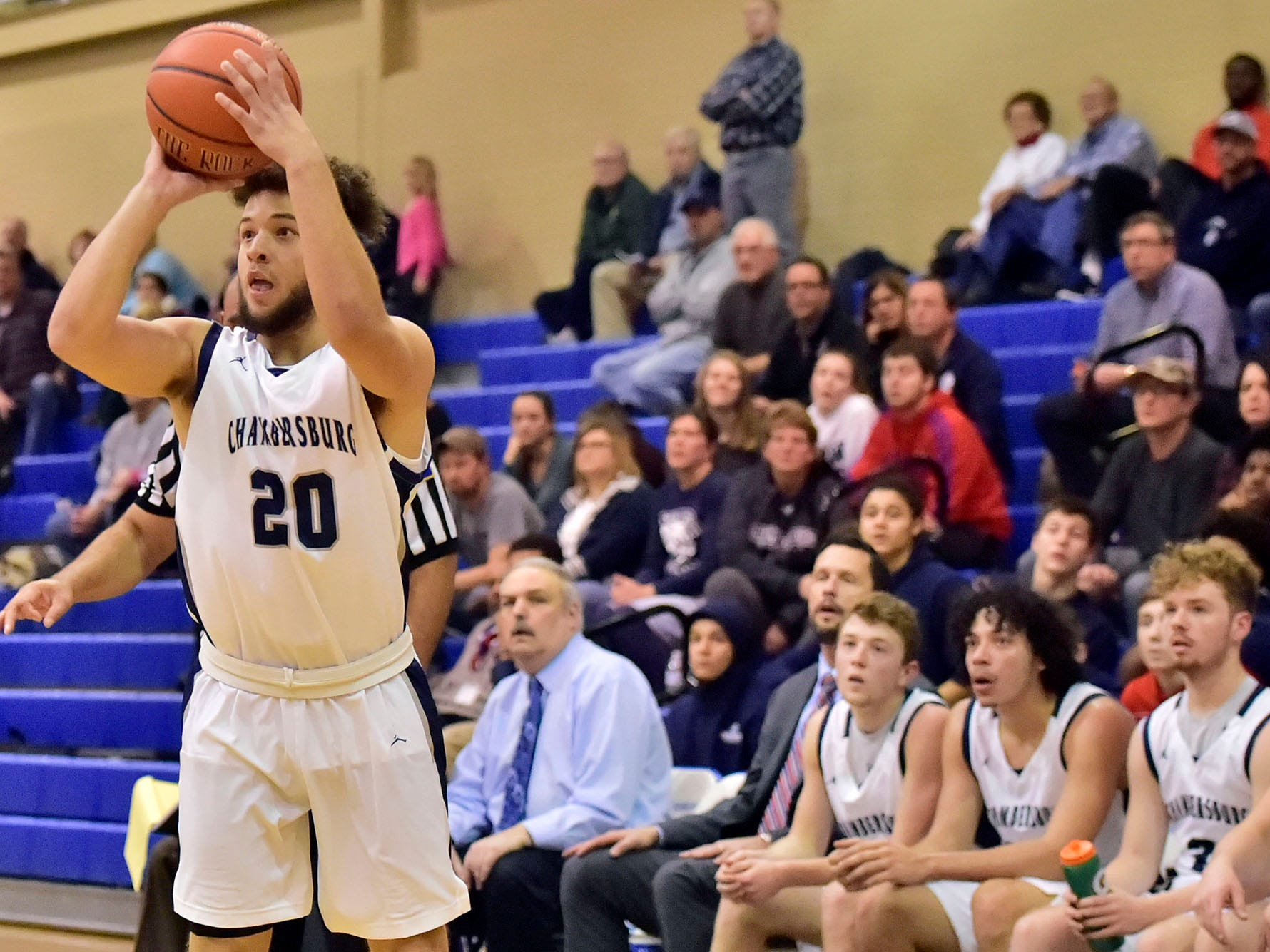 Kyere Morton (20) drops a three for the Trojans. Chambersburg dropped a buzzer-beater 42-40 to State College during  D3 basketball, Friday, Dec. 14, 2018.