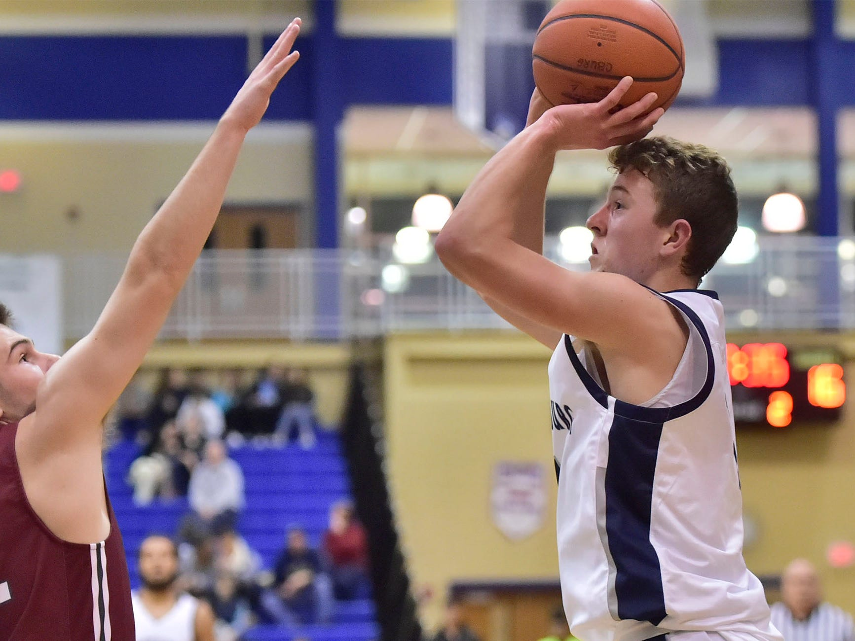 Braden Byers fires up a shot for the Trojans. Chambersburg dropped a buzzer-beater 42-40 to State College in PIAA D3 action, Friday, Dec. 14, 2018.