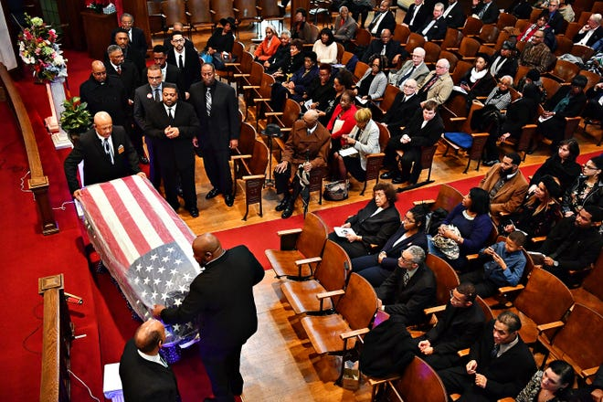 """Family, friends and community members sing """"I'll Fly Away"""" as the casket of civil rights leader Raymond """"Ray"""" Crenshaw is carried from the sanctuary during a Celebration of Life service at Bishop Small Memorial AME Zion Church in York City, Saturday, Dec. 15, 2018. Dawn J. Sagert photo"""