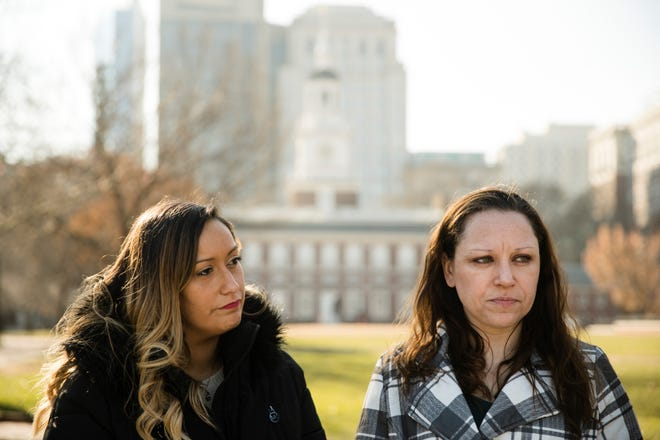 Courtney Haveman and Amanda Spillane speak with members of the media during a news conference in view of Independence Hall in Philadelphia, Wednesday, Dec. 12, 2018. Haveman and Spillane, who were denied licenses to work as estheticians as a result of running afoul of a state good moral character rule, due to past drug-related convictions, are challenging the regulation in a lawsuit. (AP Photo/Matt Rourke)