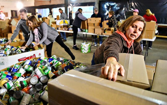 Volunteer Becky Naylor, of Windsor Township, helps to pack holiday meal boxes for the Give A Meal Program at York County Food Bank in York City, Saturday, Dec. 15, 2018. Federal Supplemental Nutrition Assistance Program benefits for February will be paid Friday, Jan. 18. Future payments are uncertain if the partial government shutdown continues.