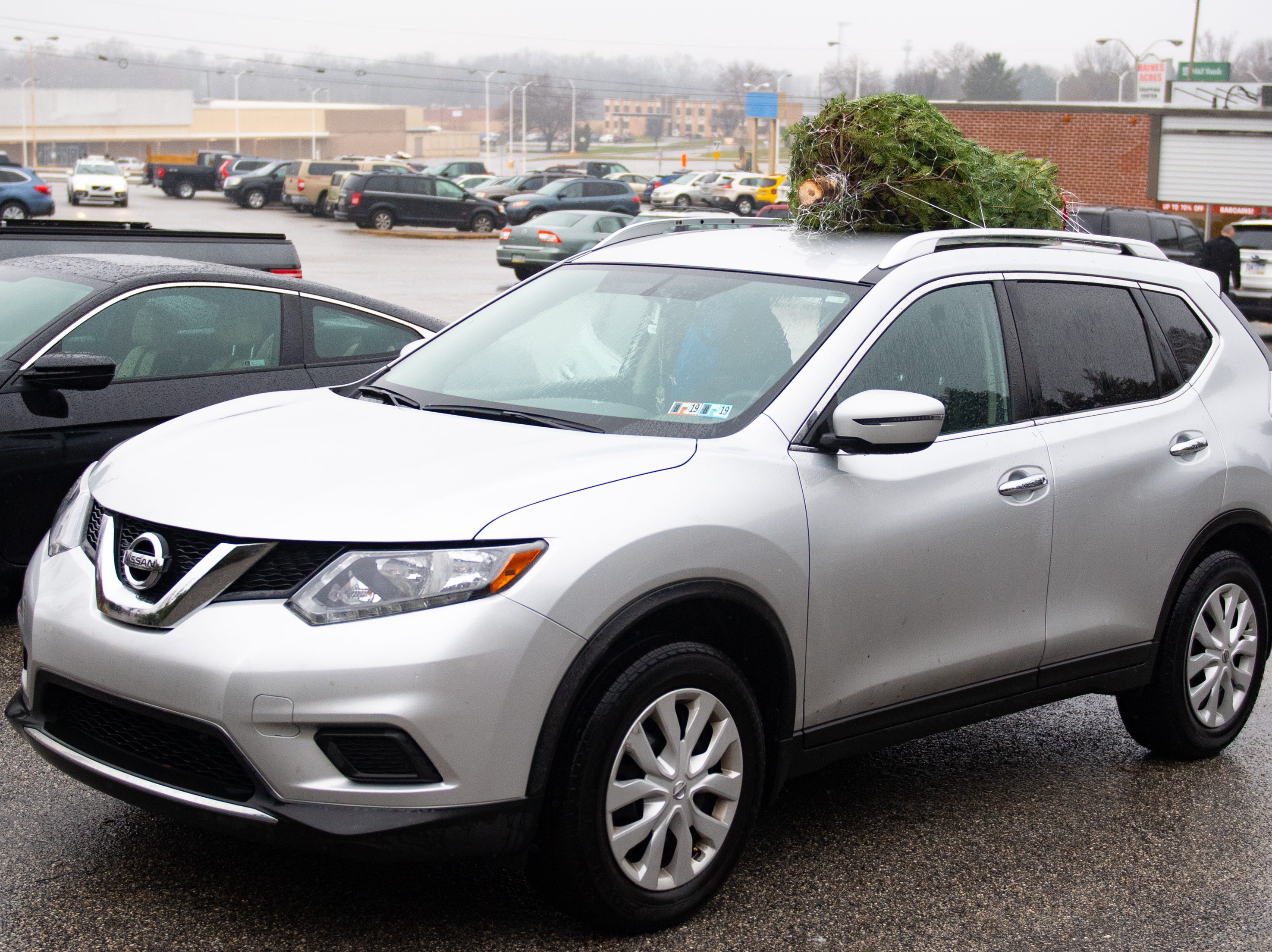 With the tree secured to the top of the SUV, the customers are all ready to go, December 15, 2018.