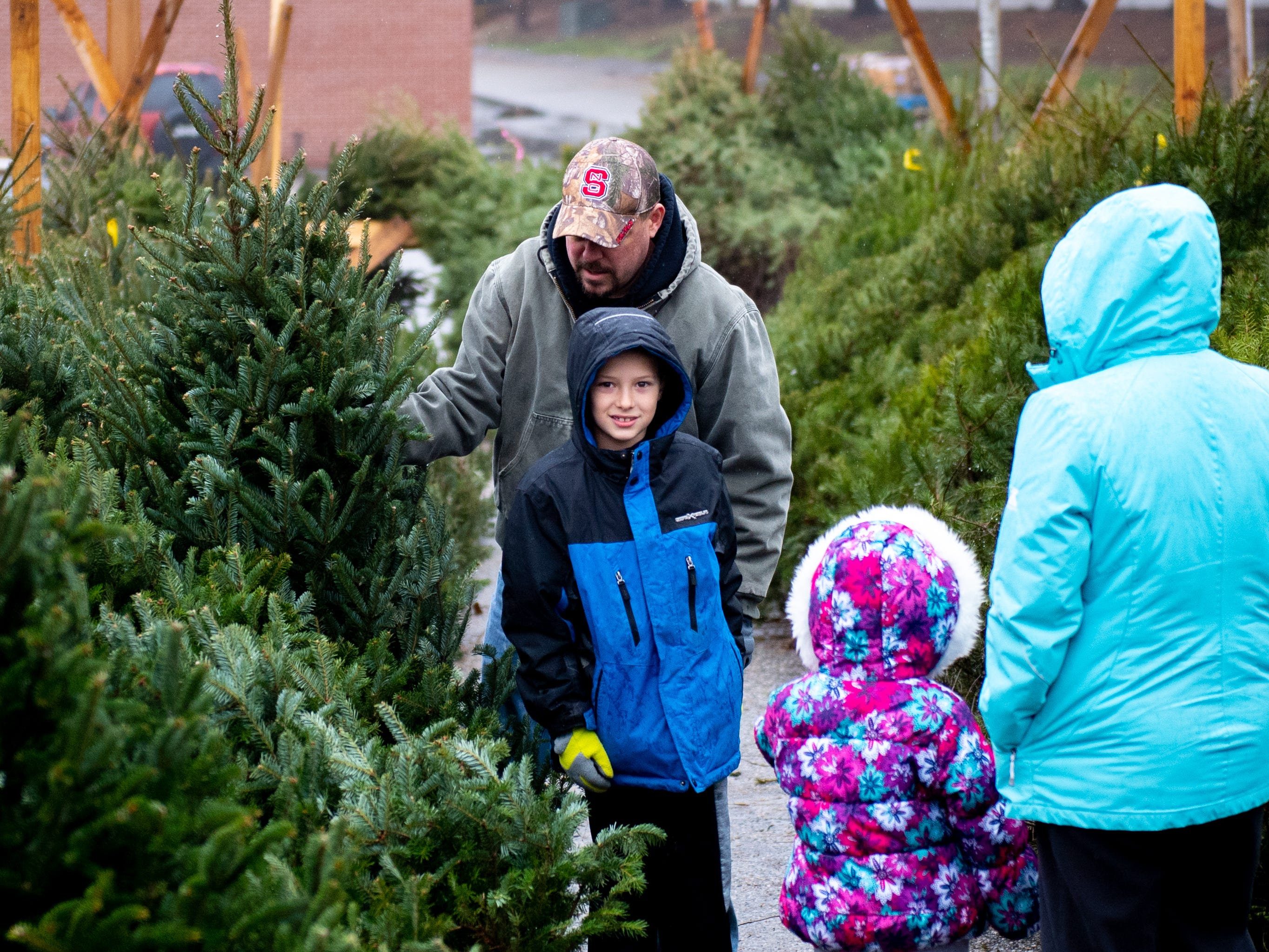 The Graver family looks for a nice full Christmas Tree at the  sale, Saturday, December 15, 2018.