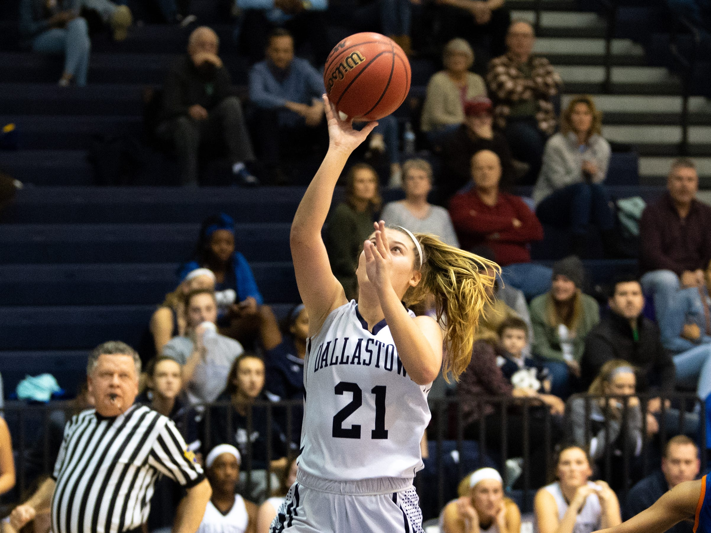Madi Moore (21) of Dallastown scores on a fast break during the girls' basketball game between Dallastown and York High at Dallastown High School, December 14, 2018. The Wildcats defeated the Bearcats 62-31.