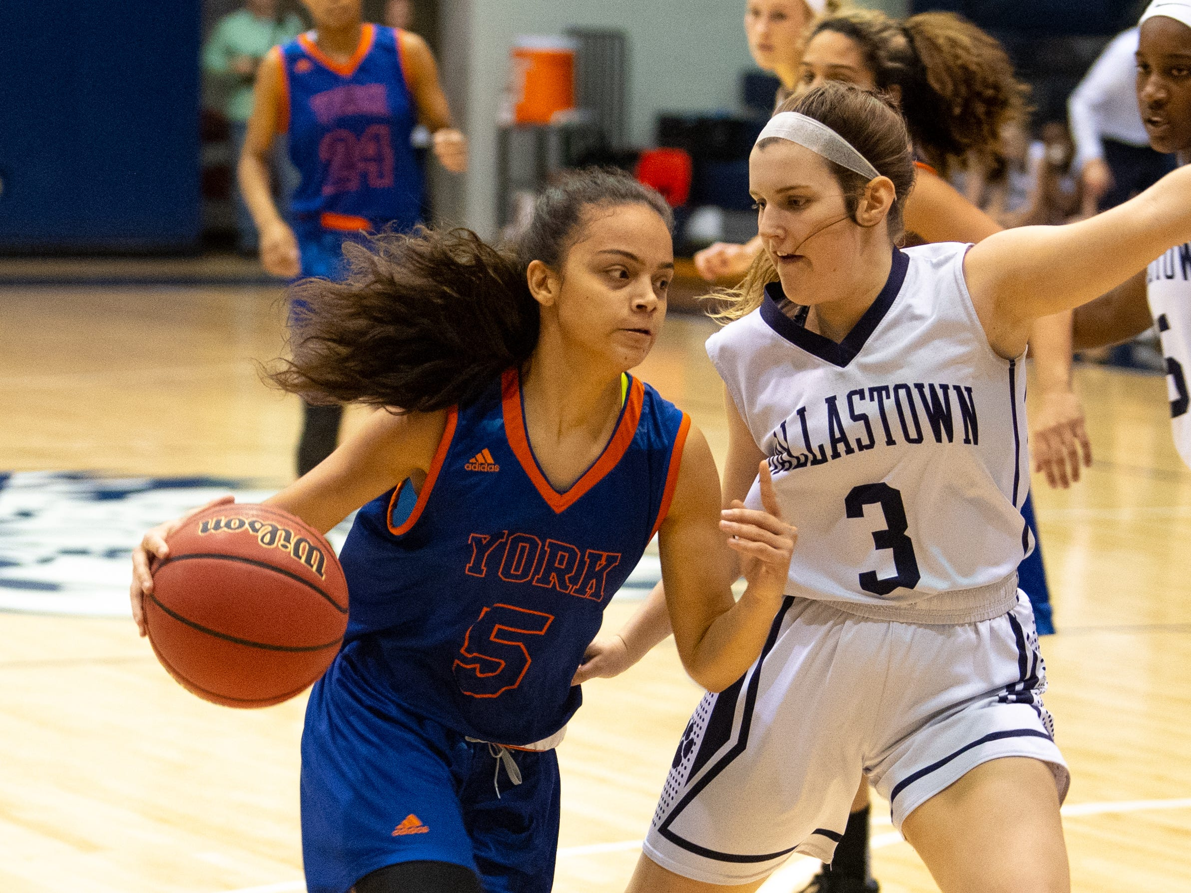 Jamison (5) tries to go past Claire Teyral (3) during the girls' basketball game between Dallastown and York High at Dallastown High School, December 14, 2018. The Wildcats defeated the Bearcats 62-31.
