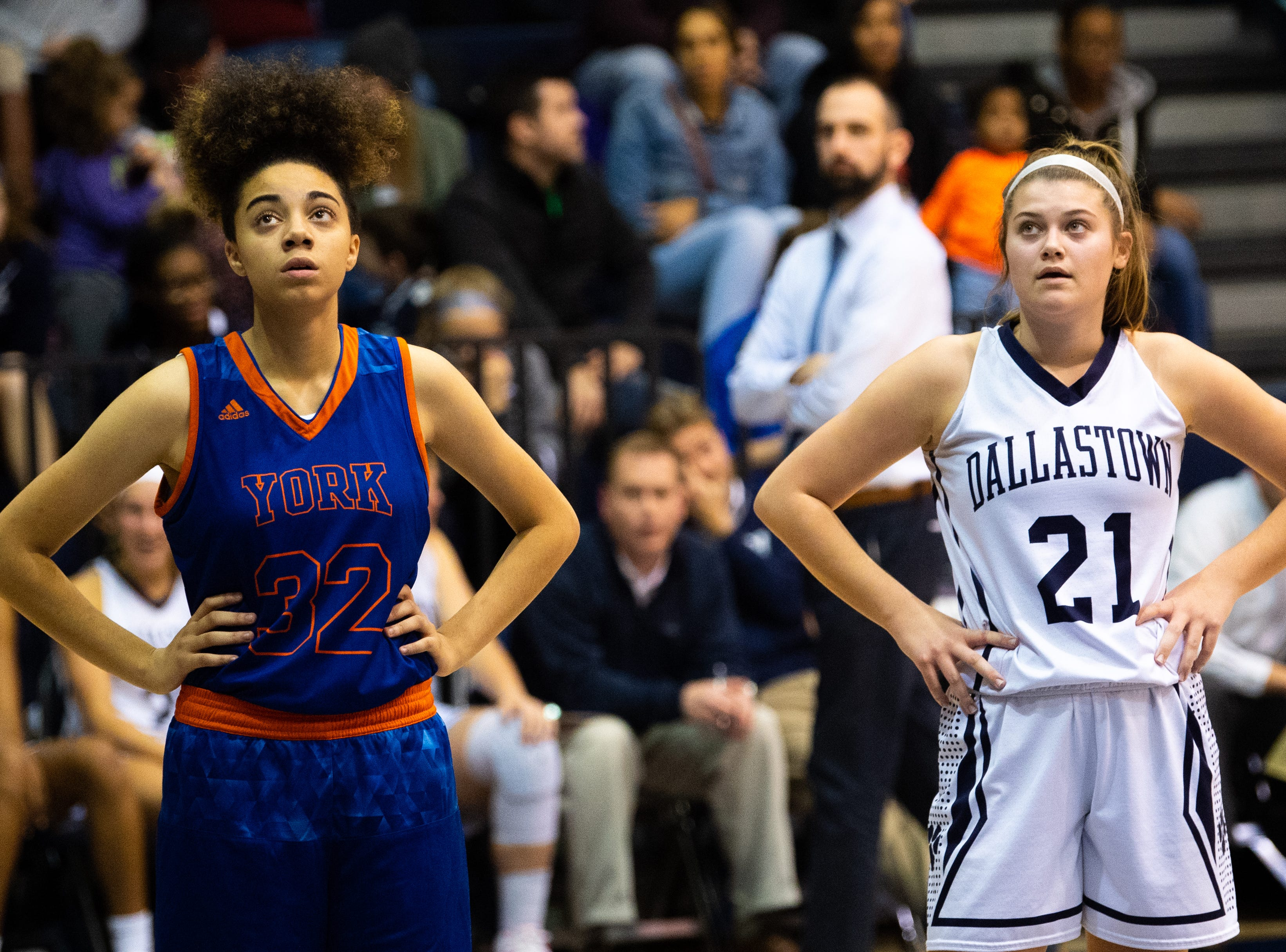Madi Moore (21) and Tyler (32) watch as a free throw is shot during the girls' basketball game between Dallastown and York High at Dallastown High School, December 14, 2018. The Wildcats defeated the Bearcats 62-31.