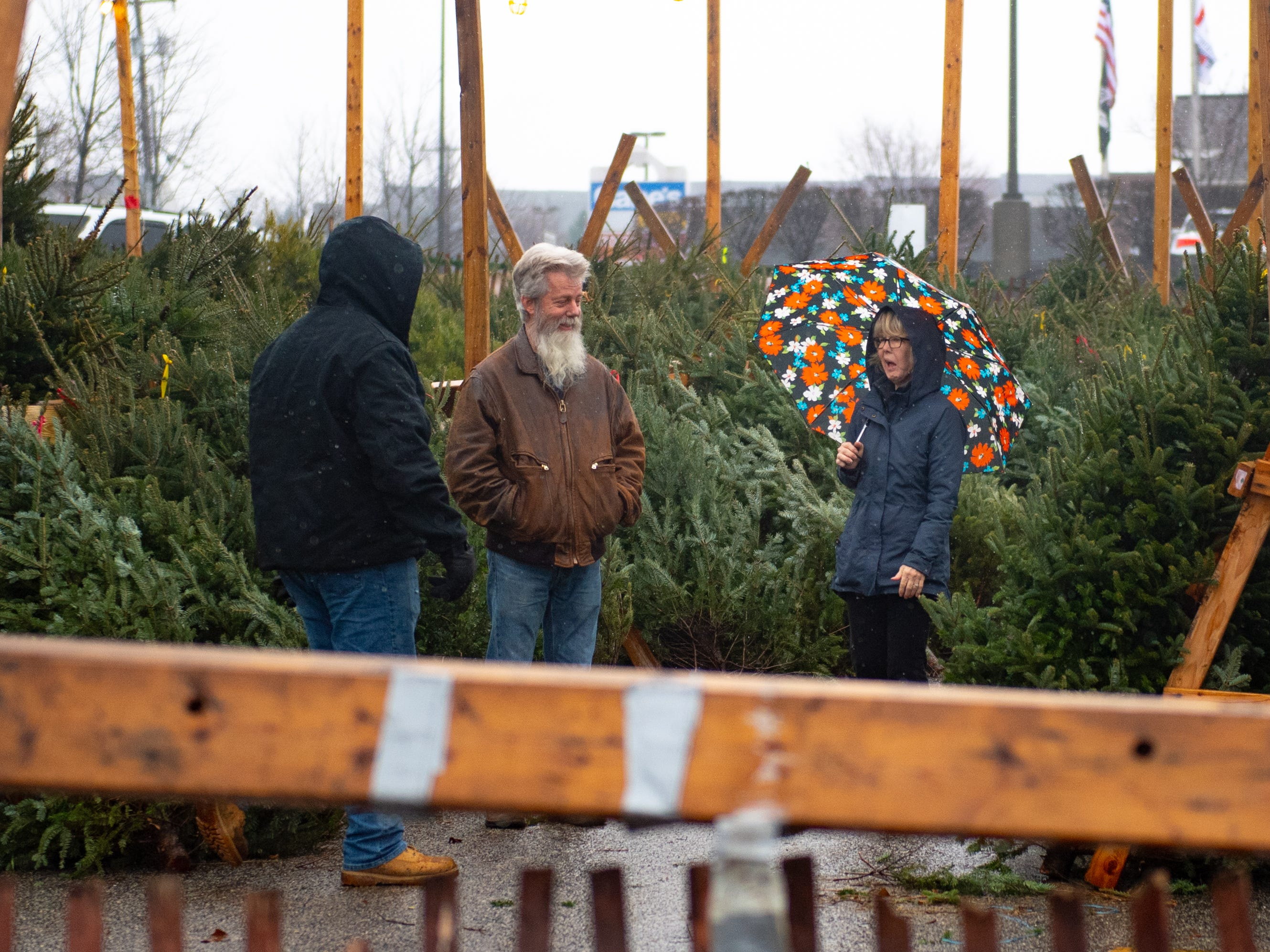 Around 100 trees are sold each week despite the wet weather that's been hitting York. Either way, customers are eager to select a tree, Saturday, December 15, 2018.