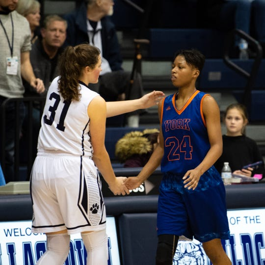 Sabria Royal (24) and Samantha Miller (31) shake hands after a hard fought game, December 14, 2018. The Wildcats defeated the Bearcats 62-31.