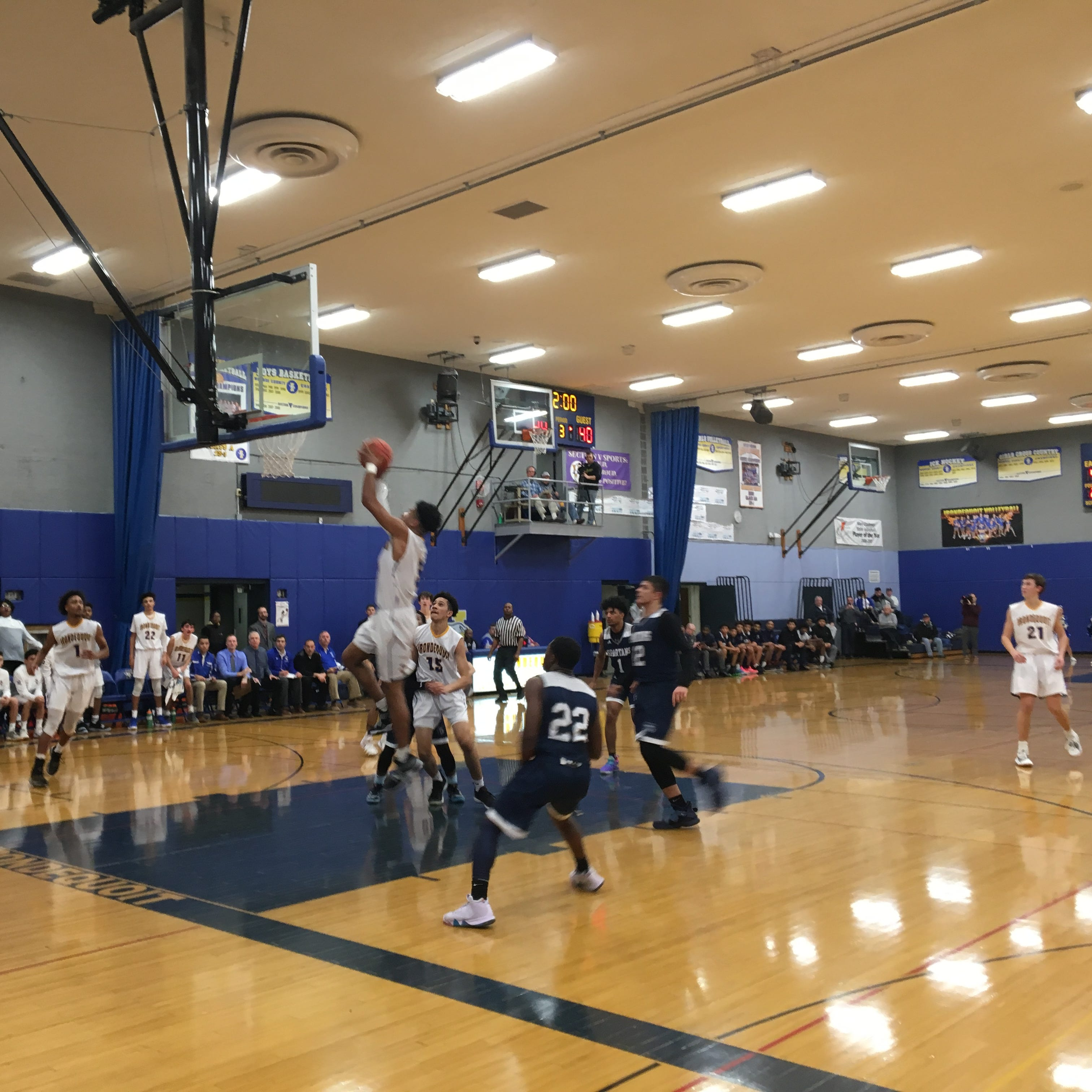 Irondequoit's Patrick Thomas goes up for a shot in third quarter