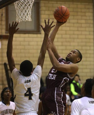 Edison's Torrean Lewis puts the ball back up over Leadership's Kennyh Hardeman.
