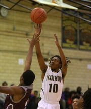 Leadership's Rondell Watson puts up a jump shot against Edison.