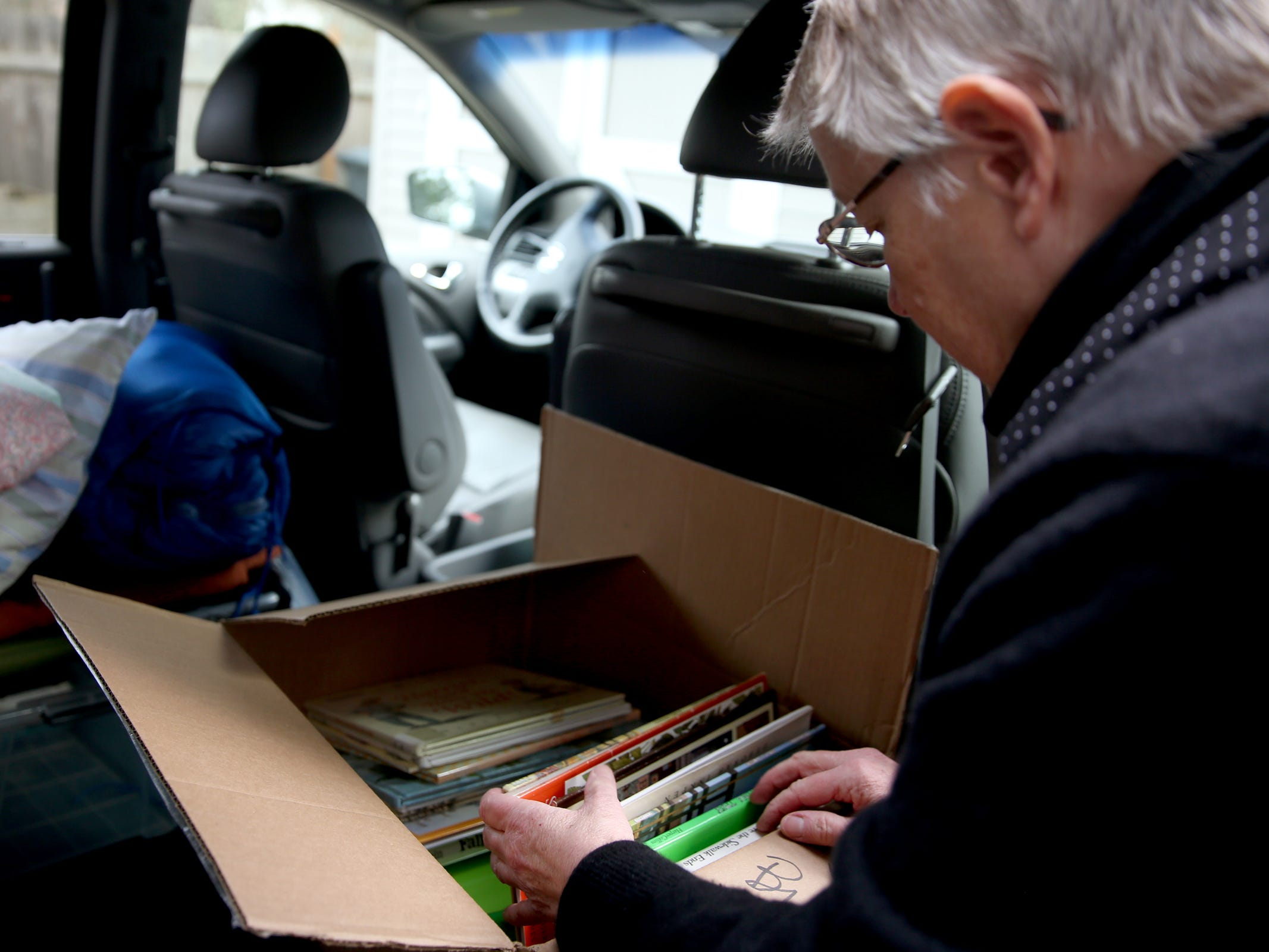 Jean Brougher will donate books to a local group when she volunteers at an animal shelter near Paradise, California following wildfires. Photographed at Brougher's home in Salem on Friday, Dec. 14, 2018.