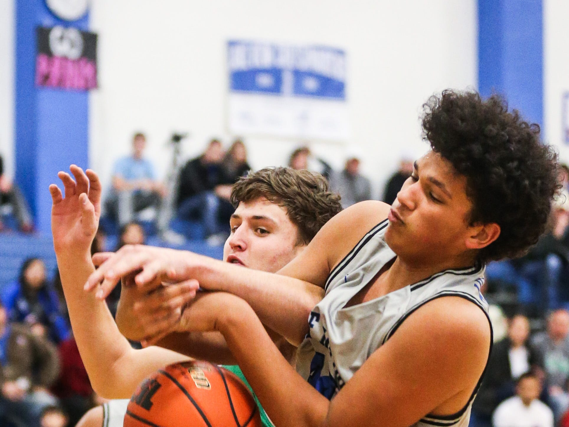 Lake View's Joseph Brooks fights for the rebound with Wall Friday, Dec. 14, 2018, at Lake View High School.