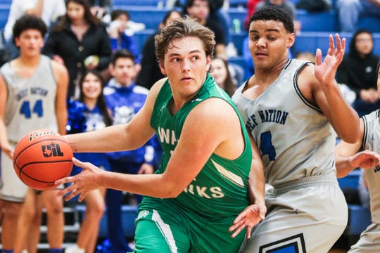 Wall's Colton Chitsey dribbles around Lake View's Kendall Blue Friday, Dec. 14, 2018, at Lake View High School.