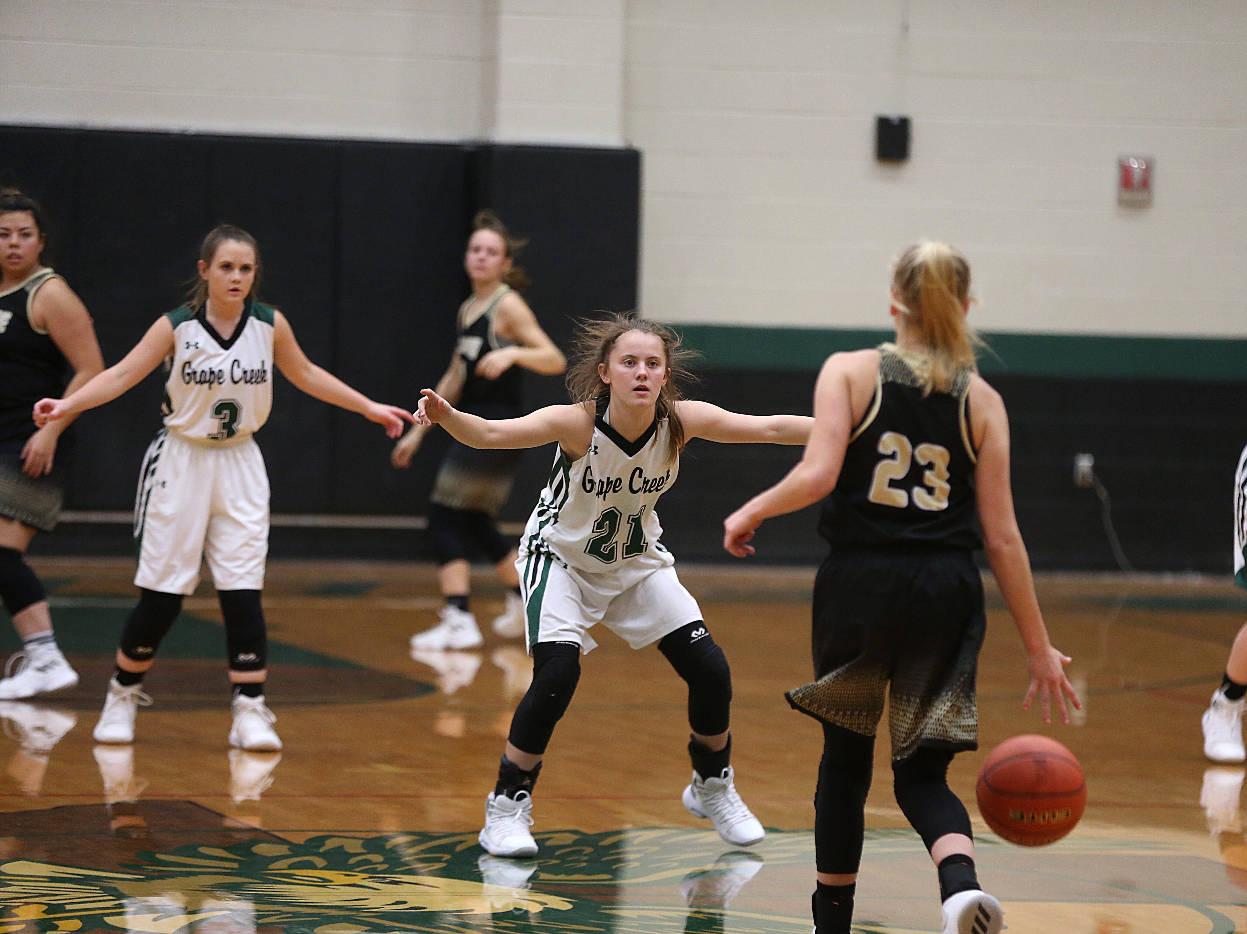 Grape Creek's Kimmy Salisbury (#21) blocks Brady's Savanna Morton (#23) as she heads to the basket Friday, Dec. 14, 2018 during their game in Grape Creek. Brady won 48 to 28.