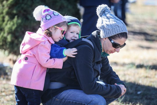 Tamsin Andela, 3, hugs Raiden Anderla, 1, by their mother Lindsey Bergeron during the Wreaths Across America ceremony Saturday, Dec. 15, 2018, at Belvedere Memorial Park.