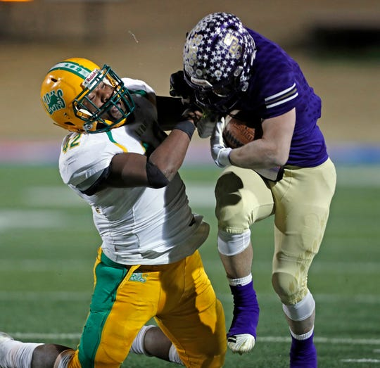New Deal's Deandre Nelson (42) tackles San Saba's Eli Salinas (8) during their state semifinal game Friday, Dec. 14, 2018, at Shotwell Stadium in Abilene.