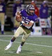 San Saba's Sean O'Keefe (17) runs with the ball during the state semifinal game against New Deal, Friday, Dec. 14, 2018, at Shotwell Stadium in Abilene.