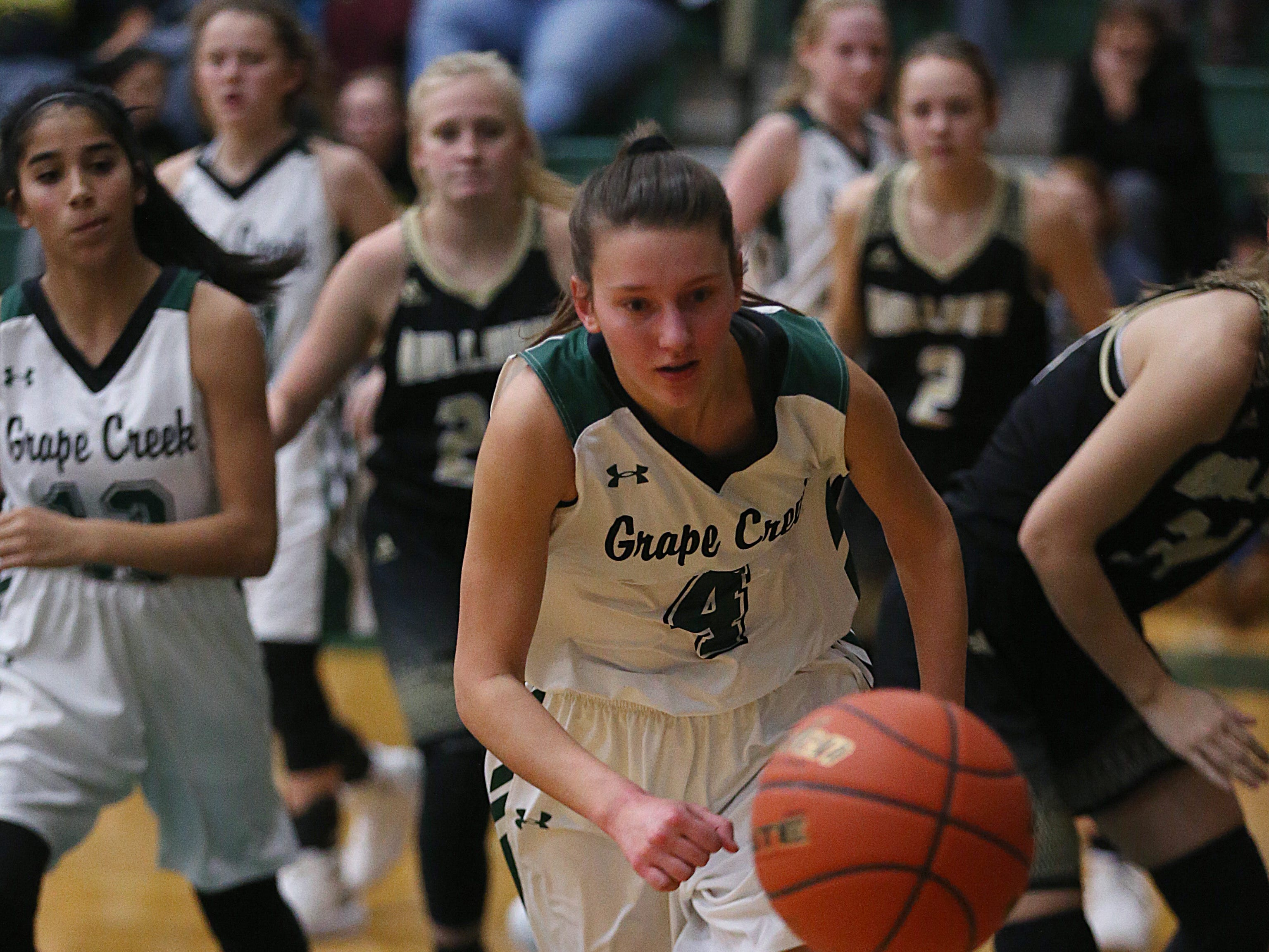 Grape Creek's Rachel Porter (#4) tries to regain control of the ball Friday, Dec. 14, 2018 during their game against Brady in Grape Creek. Brady won 48 to 28.