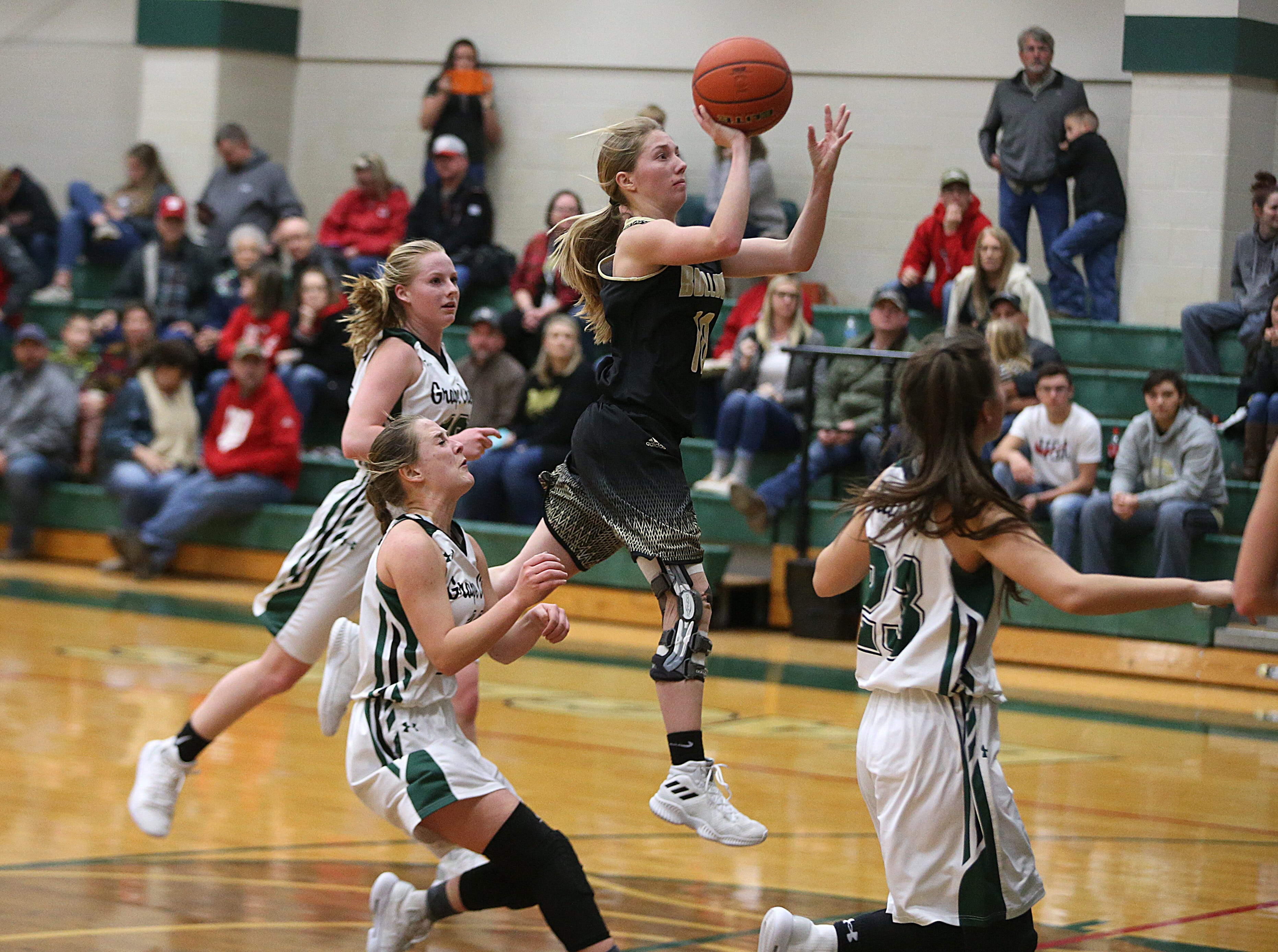 Brady's Madi Boyd (#10) jumps in the air to make a shot Friday, Dec. 14, 2018 during the Bulldog's game against Grape Creek. Brady won 48 to 28.