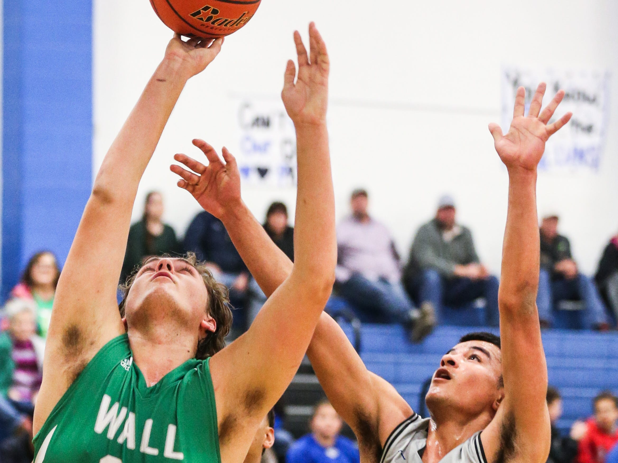 Wall's Colton Chitsey tries to shoot against Lake View Friday, Dec. 14, 2018, at Lake View High School.