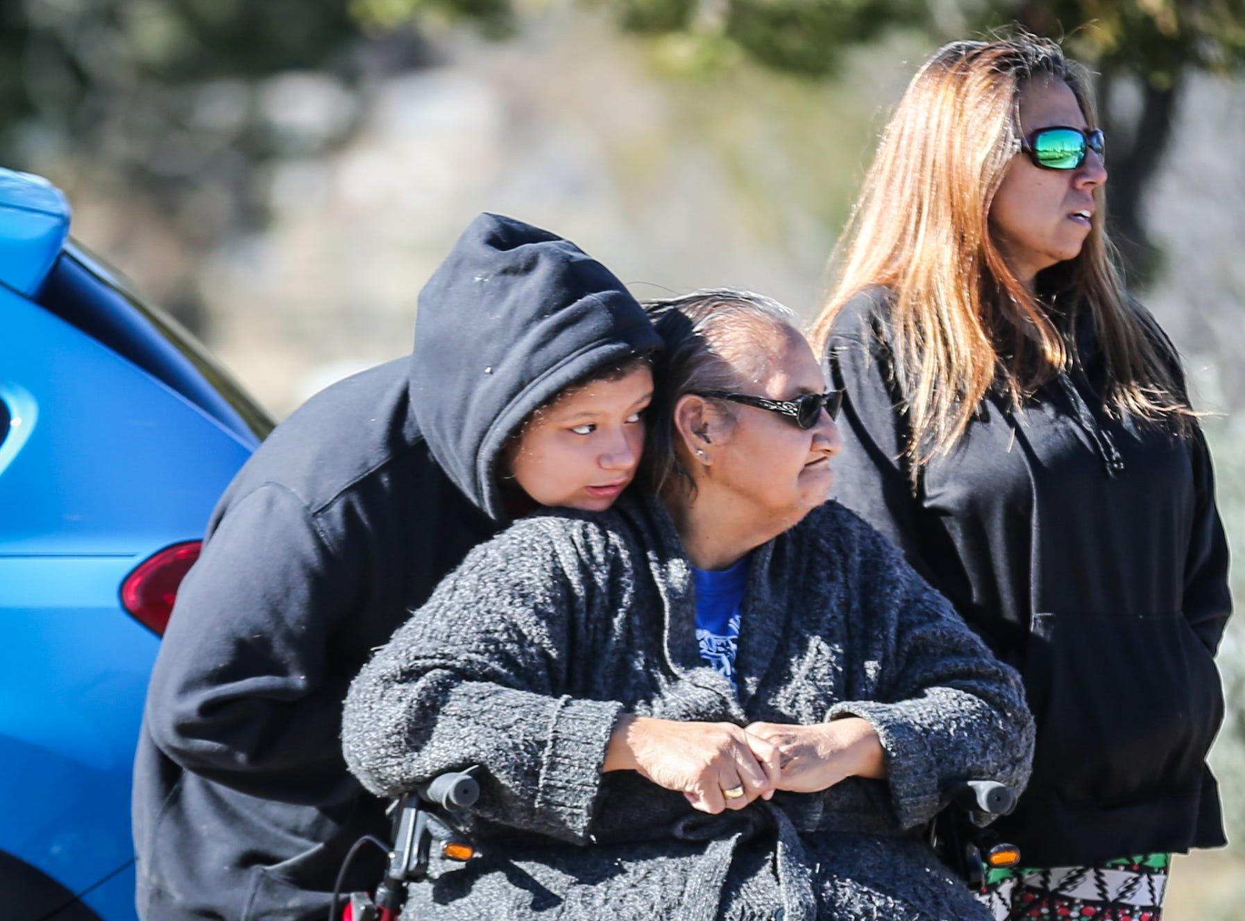Yasmin Rodriguez, 11, leans on Elva Gonzales before the Wreaths Across America ceremony Saturday, Dec. 15, 2018, at Belvedere Memorial Park.