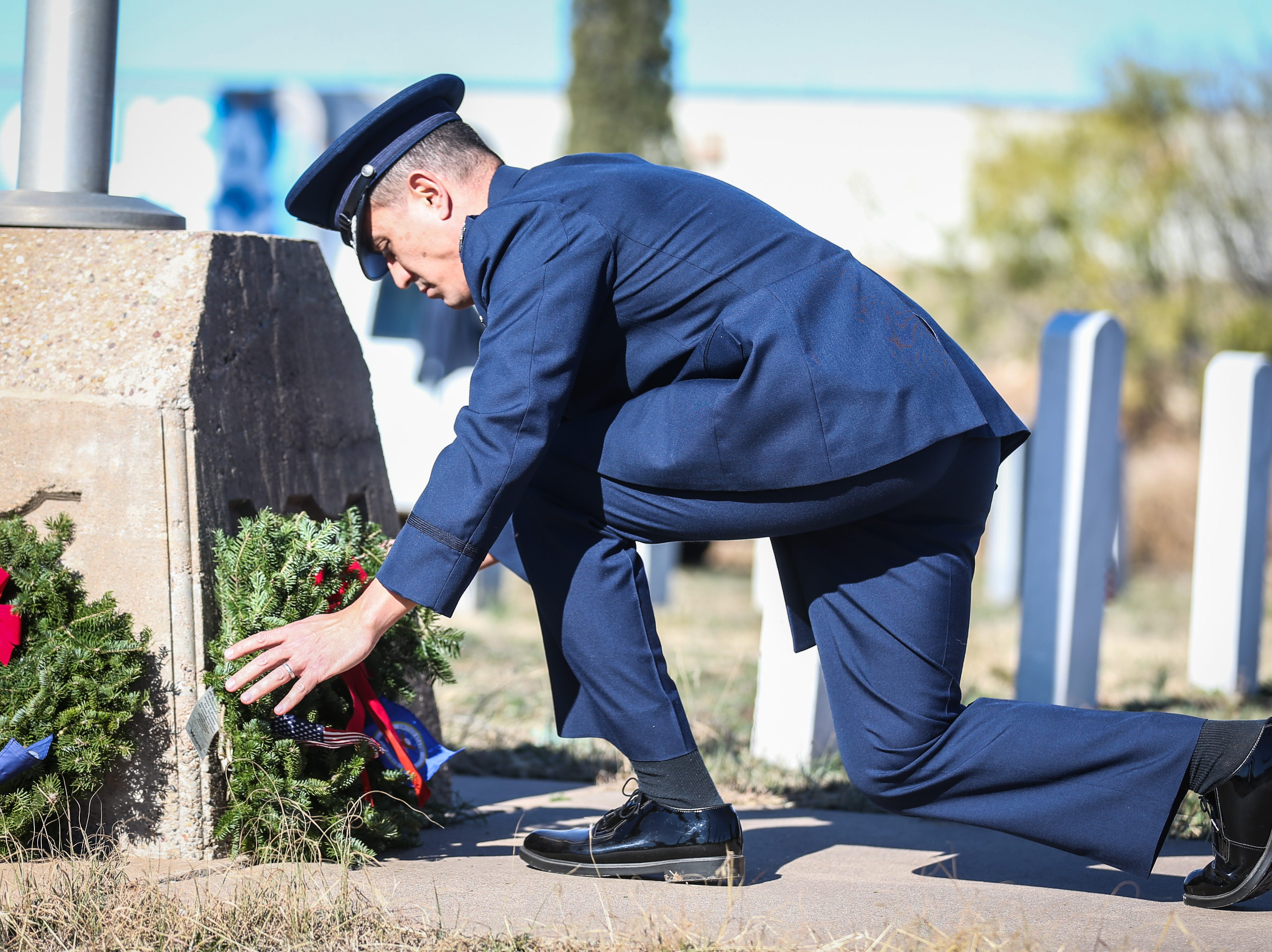 Col. Ricky Mills, Commander of the 17th Training Wing at Goodfellow Air Force Base, lays a ceremonial wreath during the Wreaths Across America Saturday, Dec. 15, 2018, at Belvedere Memorial Park.