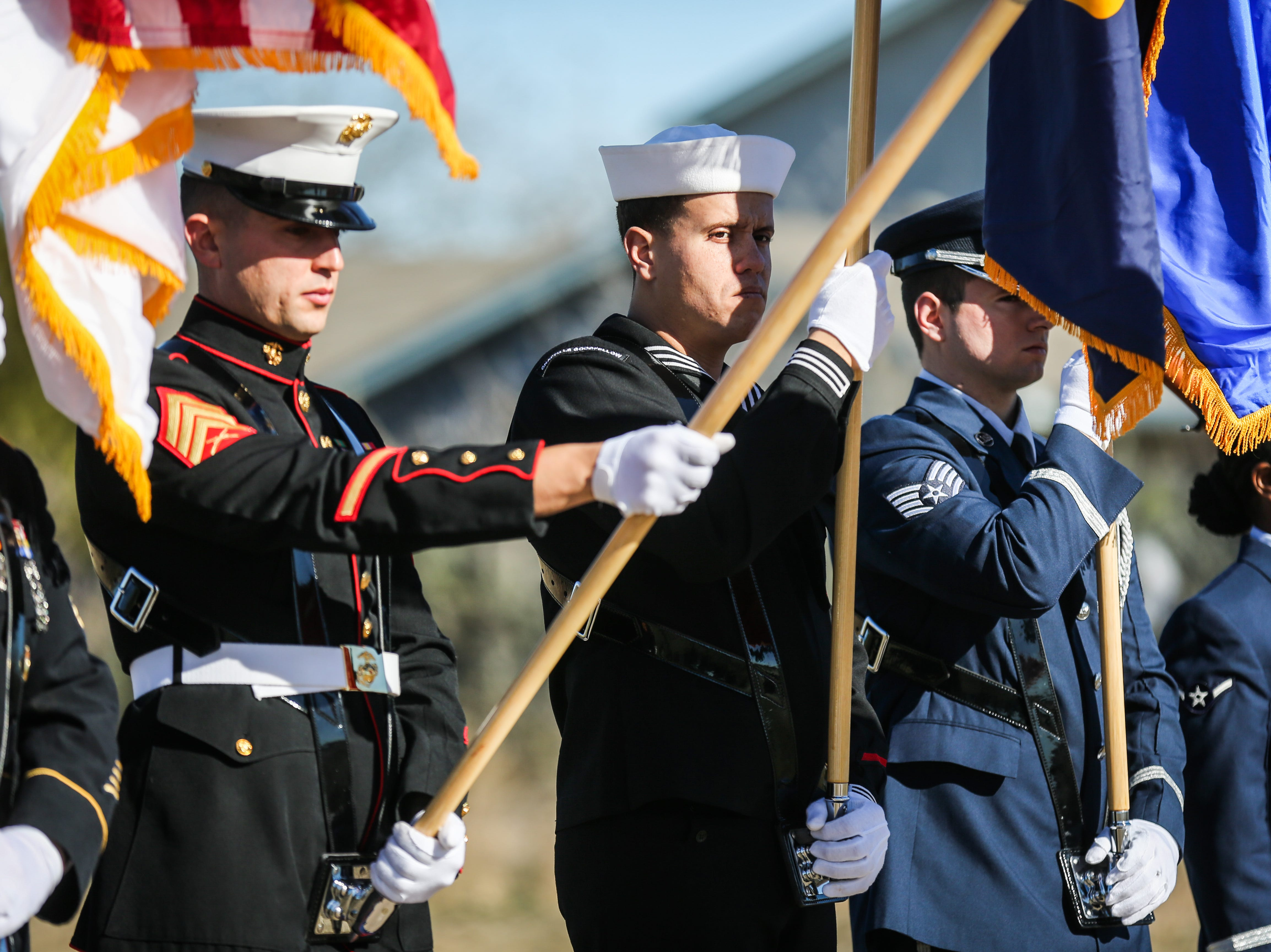 The color guard presents the flags during the Wreaths Across America ceremony Saturday, Dec. 15, 2018, at Belvedere Memorial Park.