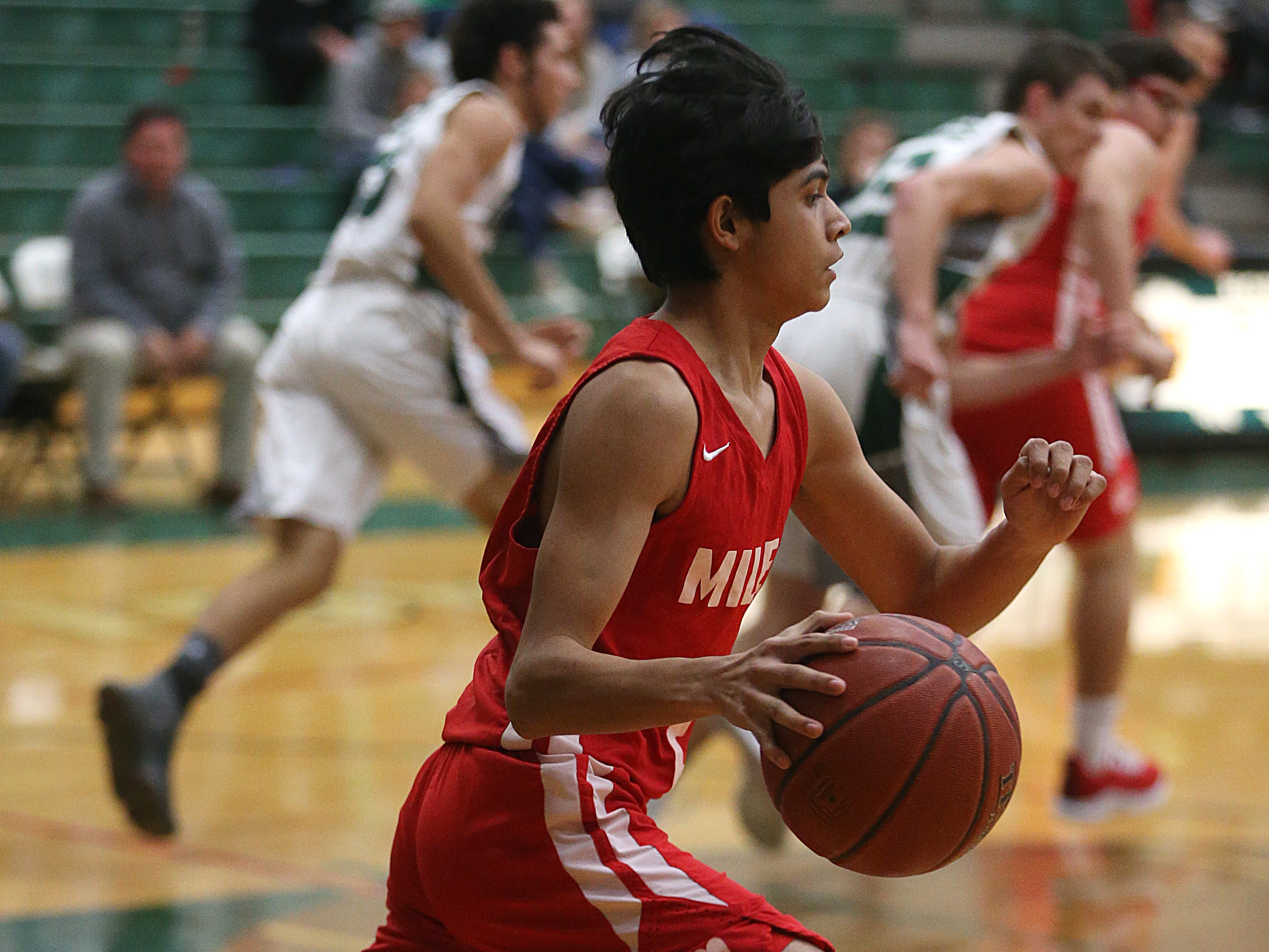 Miles' Jose Mata (#2) dribbles down court Friday, Dec. 14, 2018 during their game in Grape Creek. Miles won 50 to 38.