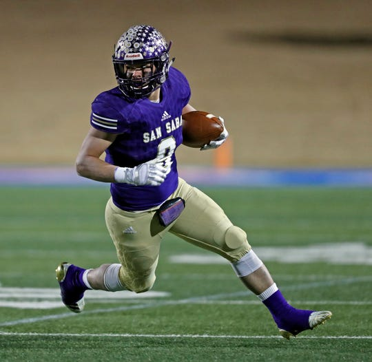 San Saba's Eli Salinas (8) runs with the ball during the state semifinal game against New Deal, Friday, Dec. 14, 2018, at Shotwell Stadium in Abilene.