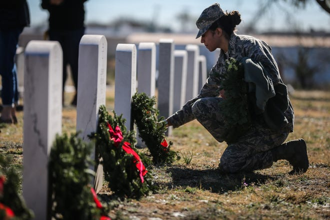 2nd Lt. Danielle Hoddy places a wreath on a grave during Wreaths Across America Saturday, Dec. 15, 2018, at Belvedere Memorial Park.