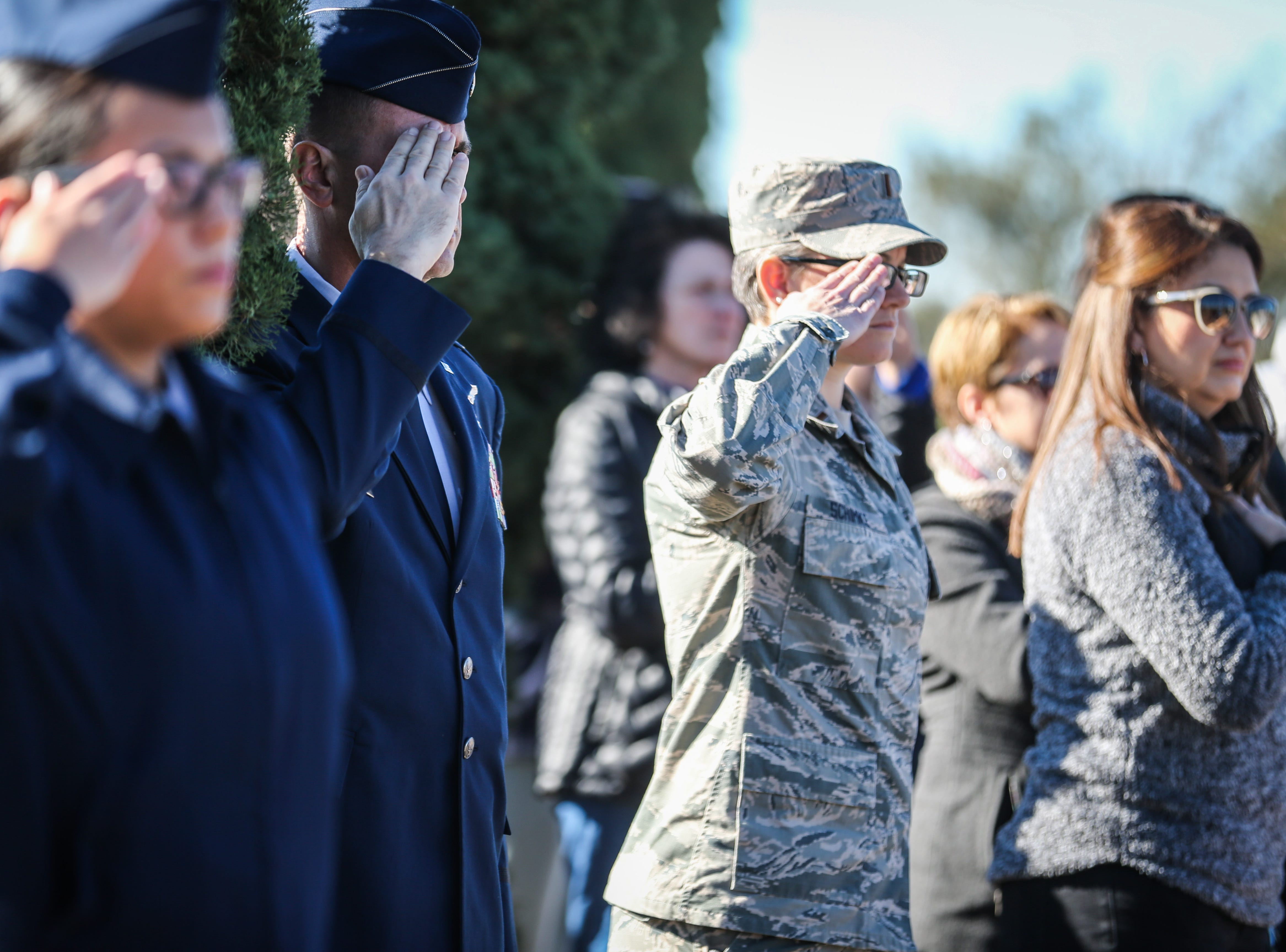 Attendees salute during the Wreaths Across America ceremony Saturday, Dec. 15, 2018, at Belvedere Memorial Park.