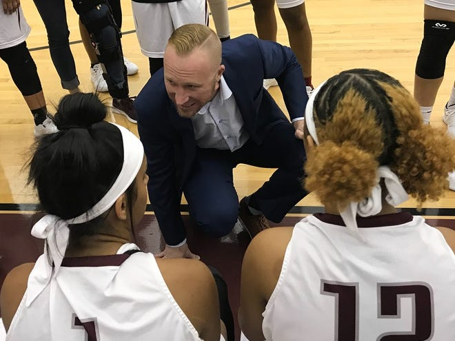 Centenary women's coach Jason Schmitz talks with his team during a timeout Saturday in the Shreveport-Bossier Holiday Classic.