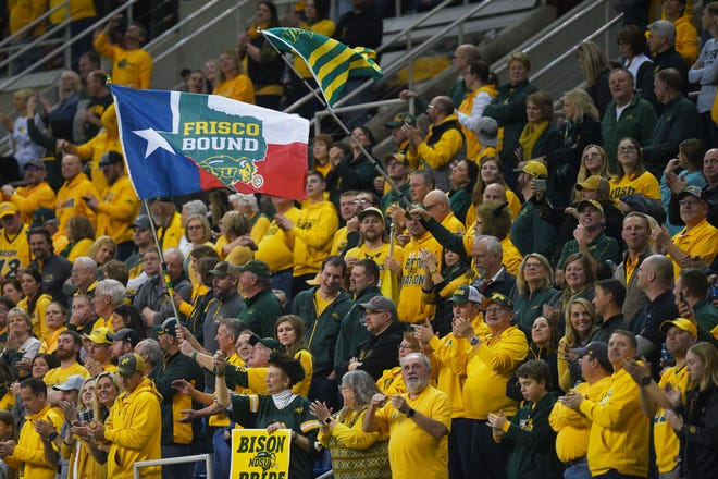 NDSU fans celebrate after their win over SDSU at the Fargodome Friday, Dec. 14, in the FCS playoffs in Fargo.