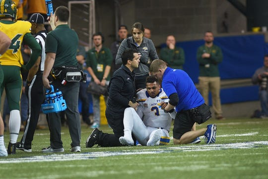 SDSU's Taryn Christion is briefly injured after a heard hit from NDSU during the game at the Fargodome Friday, Dec. 14, in the FCS playoffs in Fargo.