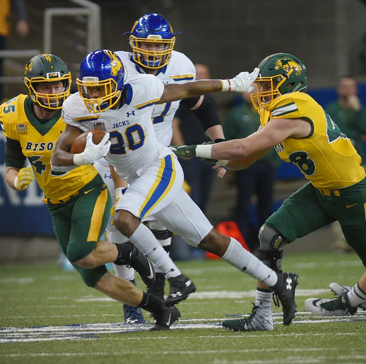 SDSU's Pierre Strong, Jr. goes against NDSU defense during the game at the Fargodome Friday, Dec. 14, in the FCS playoffs in Fargo.