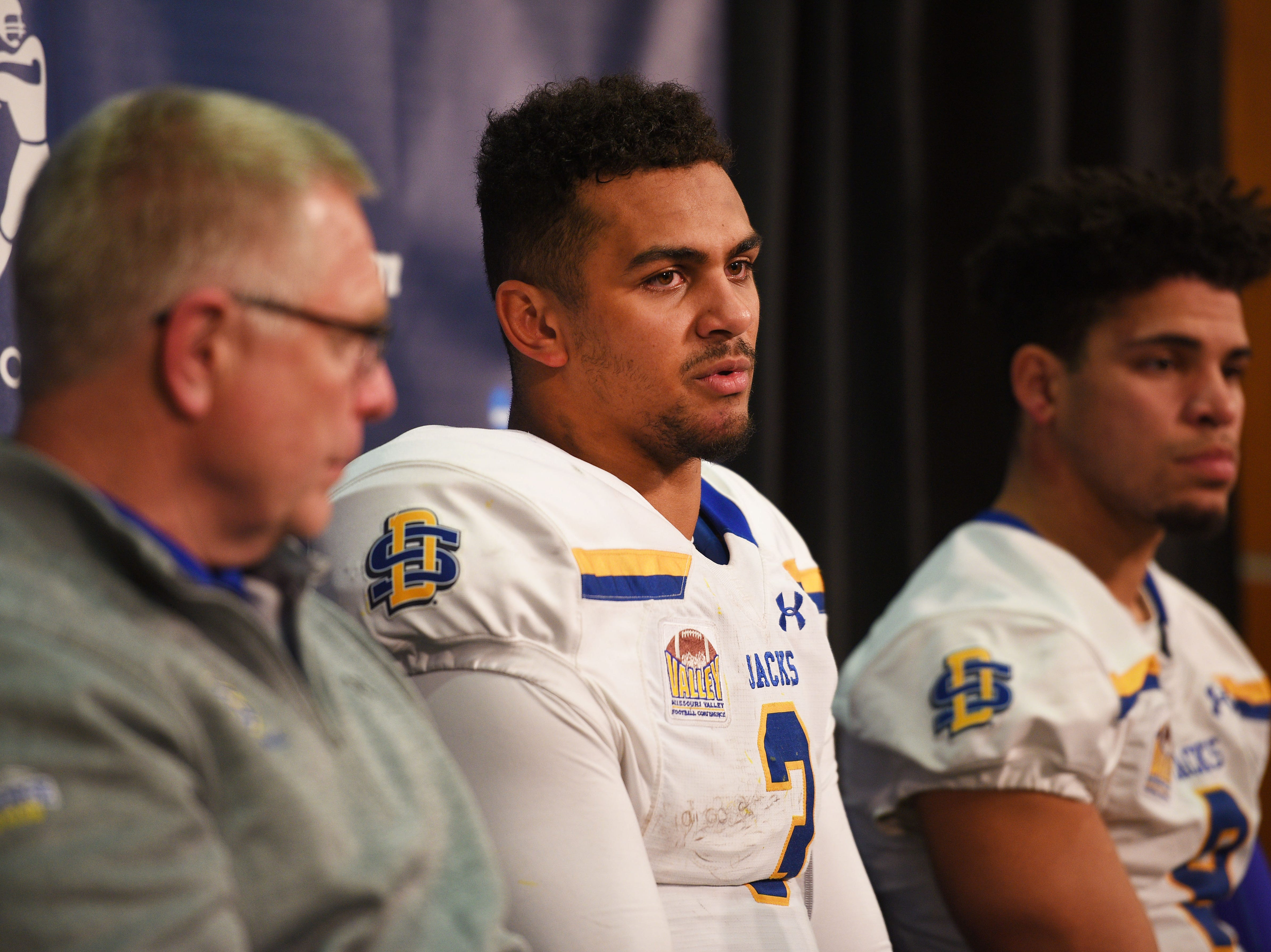 SDSU's head coach John Stiegelmeier, Taryn Christion and Jordan Brown talk in a press conference after their lose against NDSU at the Fargodome Friday, Dec. 14, in the FCS playoffs in Fargo.