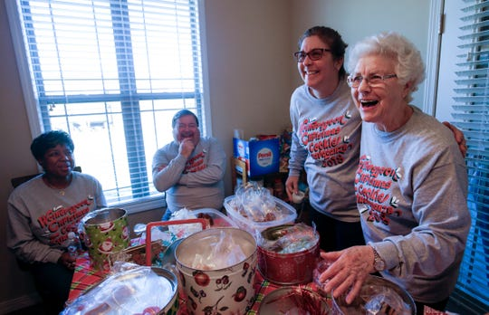 Jeanette Wotherspoon, 84, and daughter Marie Nelson laugh with friends during the annual Wotherspoon Christmas cookie extravaganza on Saturday, Dec. 15, 2018.