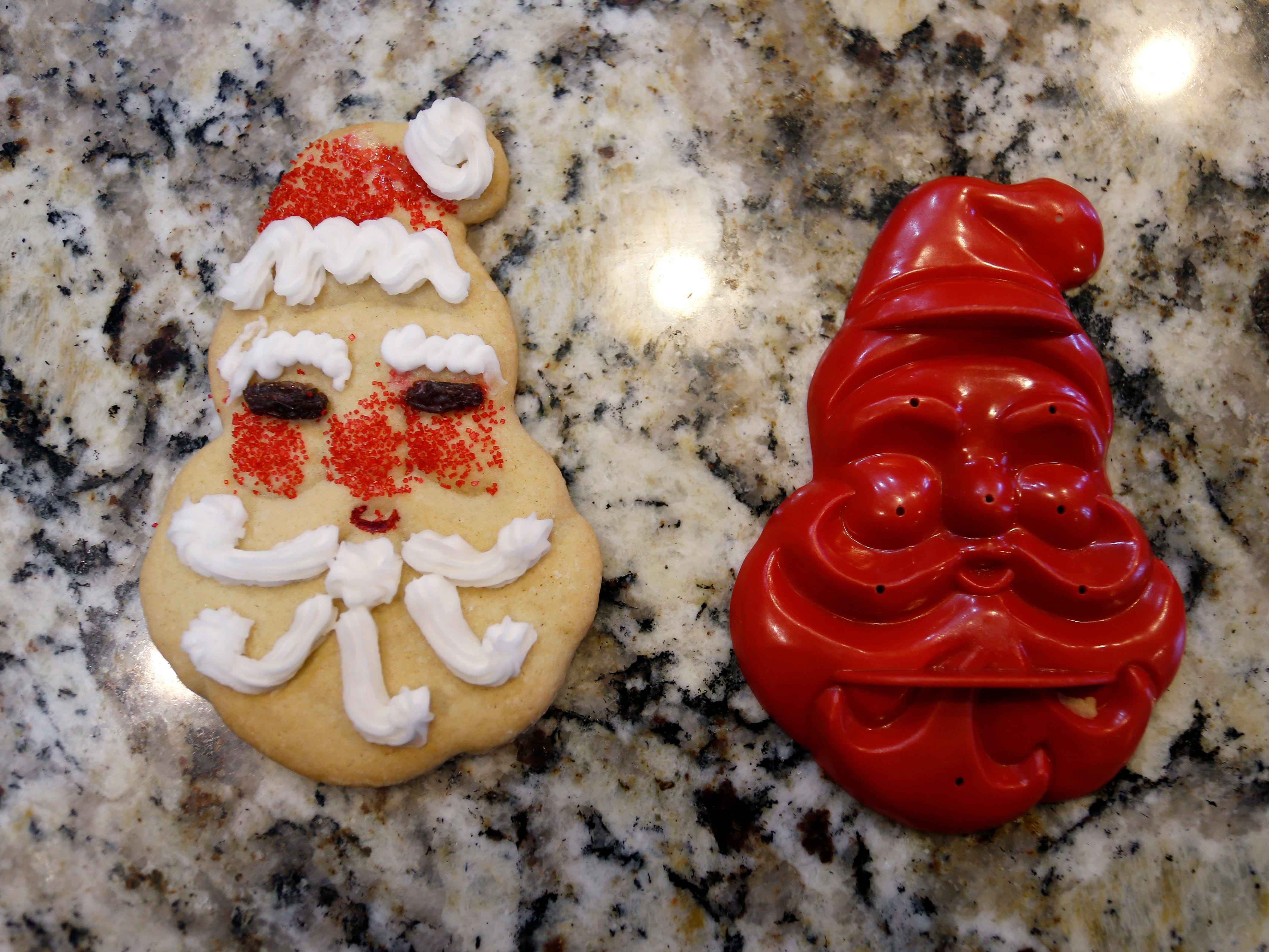 One of Jeanette Wotherspoon's oldest cookie cutters and the cookie it makes during the annual Wotherspoon Christmas cookie extravaganza.
