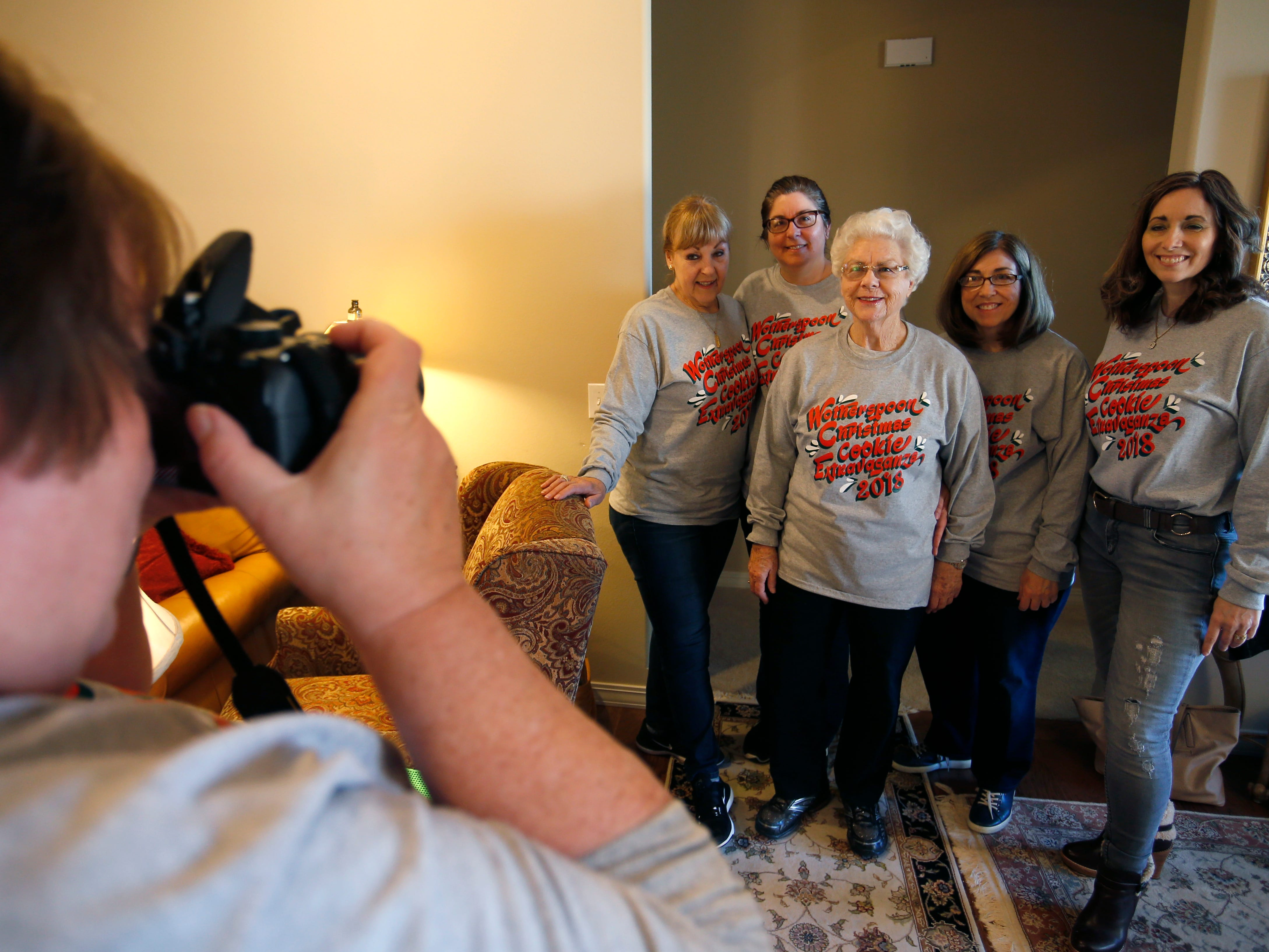 Family friend Sally Hibbs takes a photo of Jeanette Wotherspoon (center) and her daughters (from left) Ramona DeArmond, Marie Nelson, Rebecca Wotherspoon and Barbara Wotherspoon during the Wotherspoon Christmas cookie extravaganza on Saturday, Dec. 15, 2018.