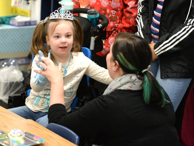 """Lucy Rhoden and her mom, Melissa Rhoden, celebrated receiving a trip to Disney World through Make-A-Wish. To celebrate, Lucy Rhoden's second-grade class at Bessie Weller held a """"Frozen"""" party Friday."""
