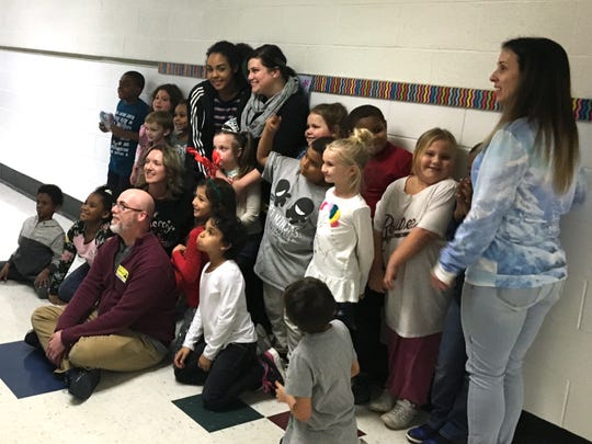 Lucy Rhoden's second-grade class at Bessie Weller gathered together to have their photo taken by a Make-A-Wish representative Friday. Make-A-Wish is sending Rhoden and her family to Disney World.
