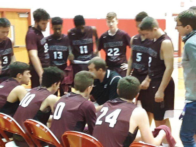 Stuarts Draft coach Mike Gale talks to his team during Friday night's game at East Rockingham.