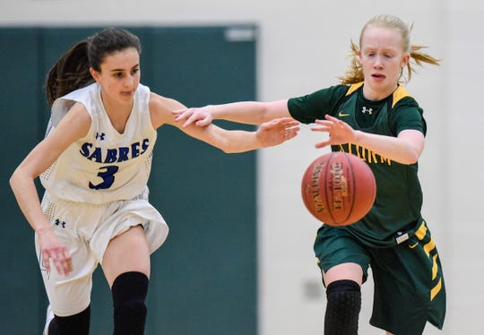 Sartell's Megan Driste and Sauk Rapids' Grace Roesch chase a loose ball during the first half Friday, Dec. 14, at the Sauk Rapids-Rice High School.