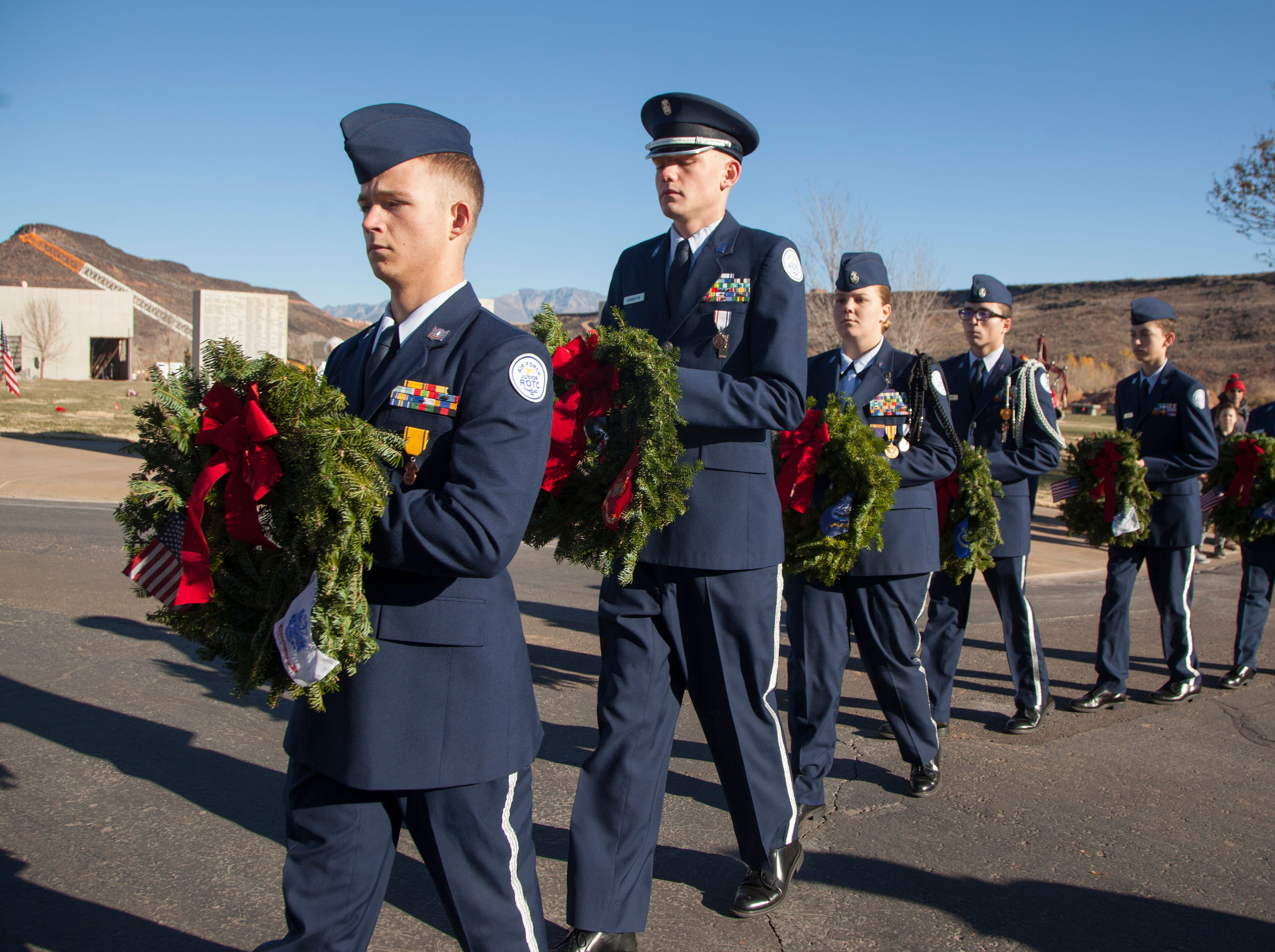 Community members carry wreaths that will placed on the headstones of veterans at the Tonaquint Cemetery in St. George as part of the Wreaths Across America Saturday, Dec. 15, 2018.