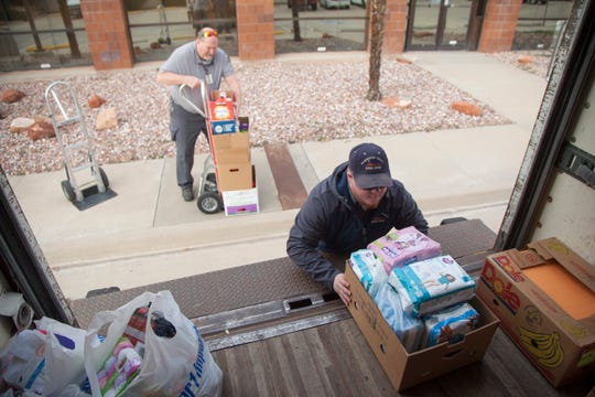 Representatives from the Washington County School District load Step Up donations in the Spectrum & Daily News parking lot in St. George on Monday, Dec. 10, 2018.
