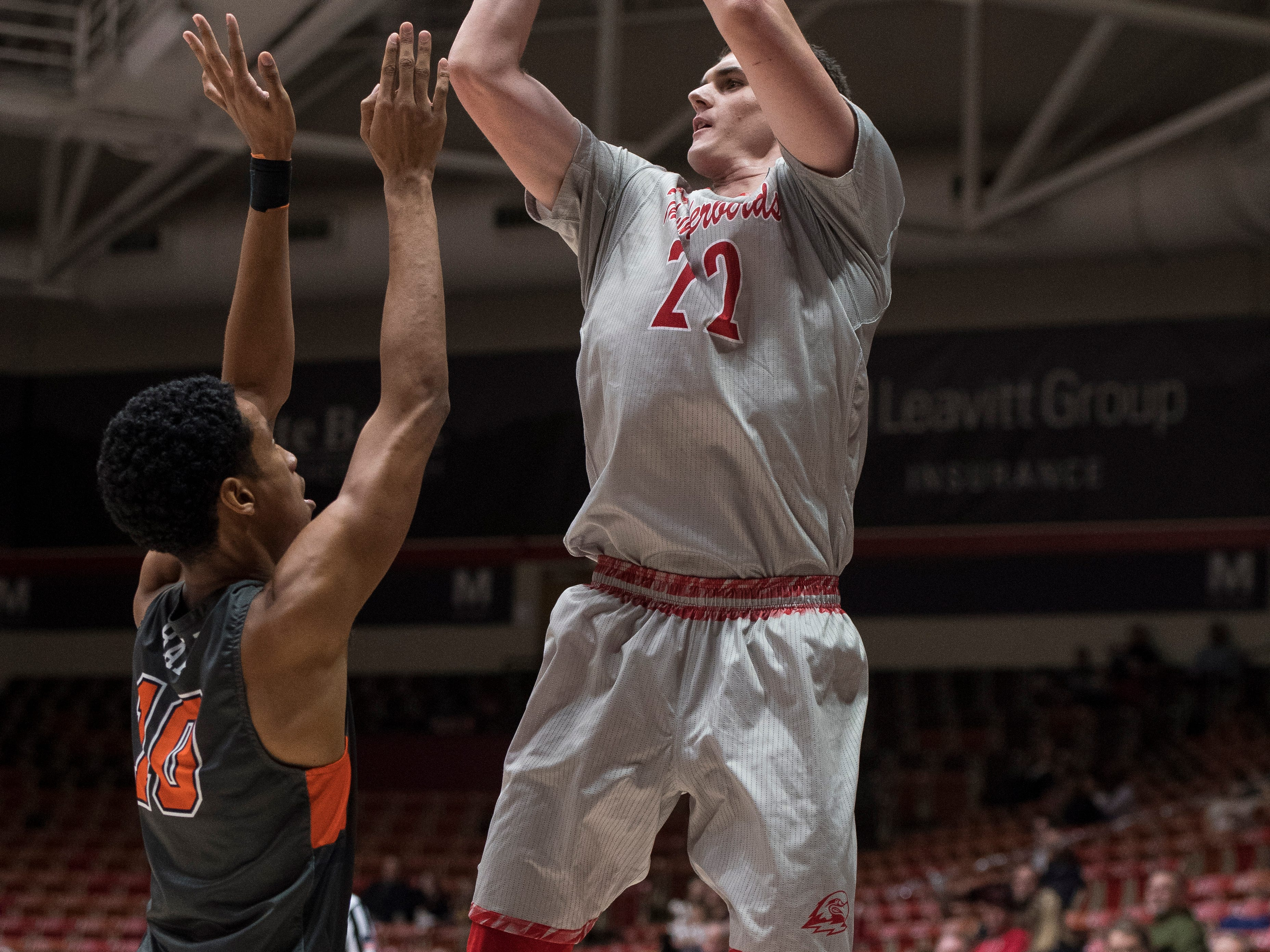 Southern Utah University junior Ivan Madunic (22) takes a shot against Pepperdine University in the America First Event Center Saturday, December 15, 2018. SUU won in overtime, 78-69.