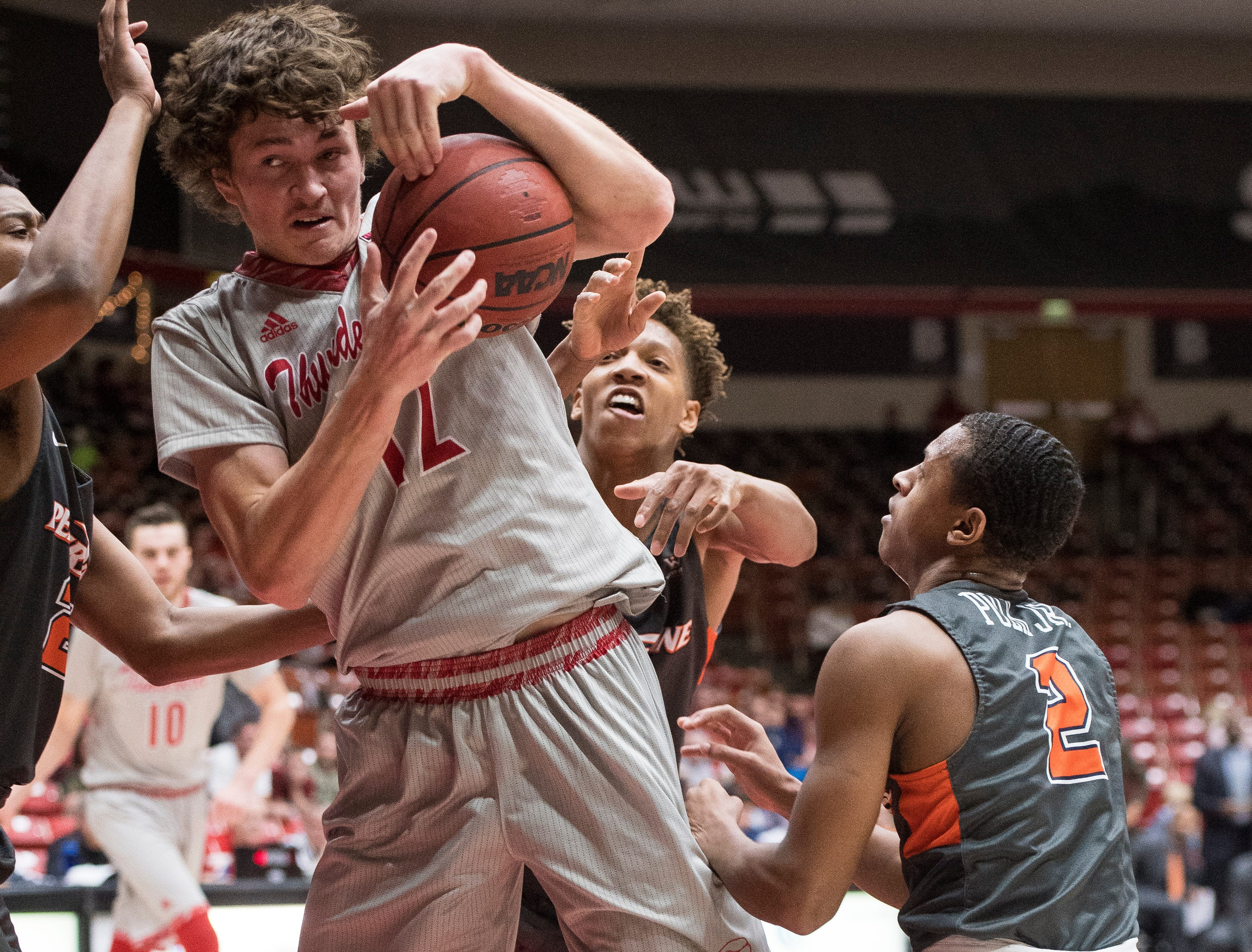 Southern Utah University freshman Maizen Fausett (12) fights for a rebound against Pepperdine University in the America First Event Center Saturday, December 15, 2018. SUU won in overtime, 78-69.